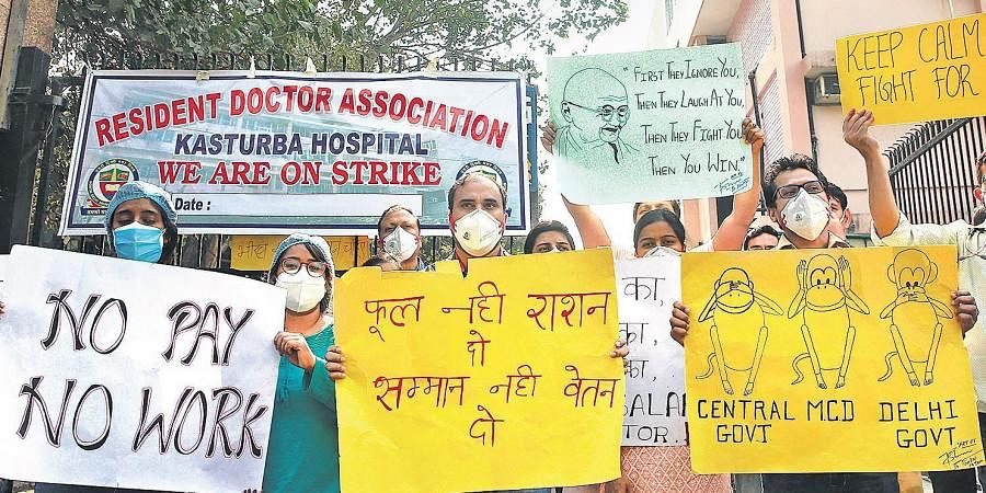 Resident doctors of Kasturba Hospital protest over non-payment of their pending salaries by North Delhi Municipal Corporation in New Delhi.