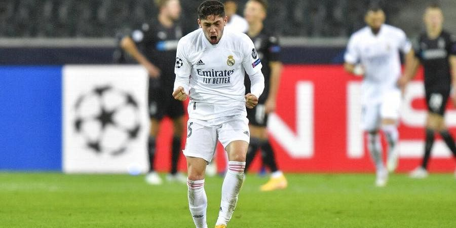 Real Madrid's Federico Valverde celebrates after Real Madrid's Casemiro scored his side's second goal during the Champions League. (Photo | AP)