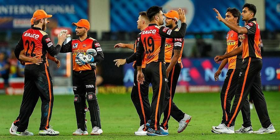 Sunrisers Hyderabad players celebrate during the IPL match against Delhi Capitals at the Dubai International Cricket Stadium.