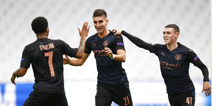 Manchester City's Ferran Torres, centre, is congratulated by teammate's Raheem Sterling, left, and Phil Foden, right, after scoring his team's first goal. (Photo   AP)
