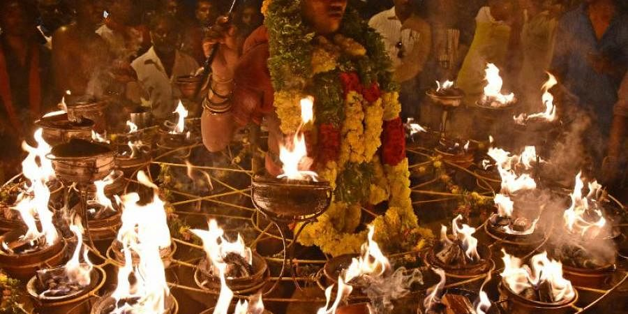 A devotee making an offering by piercing his mouth with a long 'vel' at Thoothukudi on the occasion of dasara festival