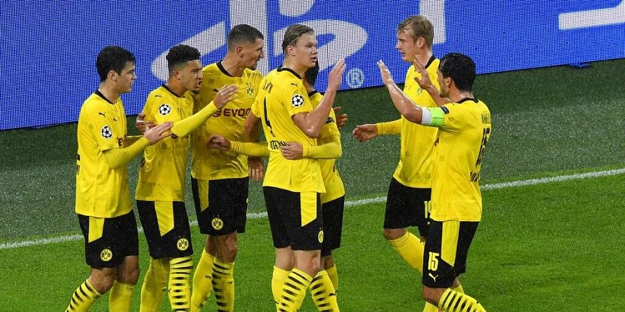 Dortmund's Jadon Sancho, second left, celebrates after scoring his side's opening goal from the penalty spot