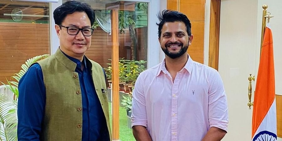 Union Sports Minister Kiren Rijiju with former India batsman Suresh Raina