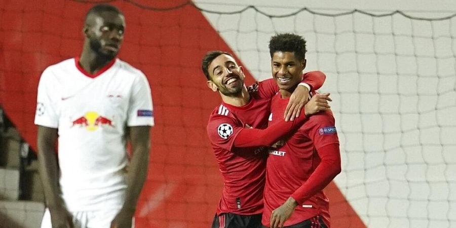 Manchester United's Marcus Rashford, right, celebrates with Manchester United's Bruno Fernandes after scoring his side's second goal.