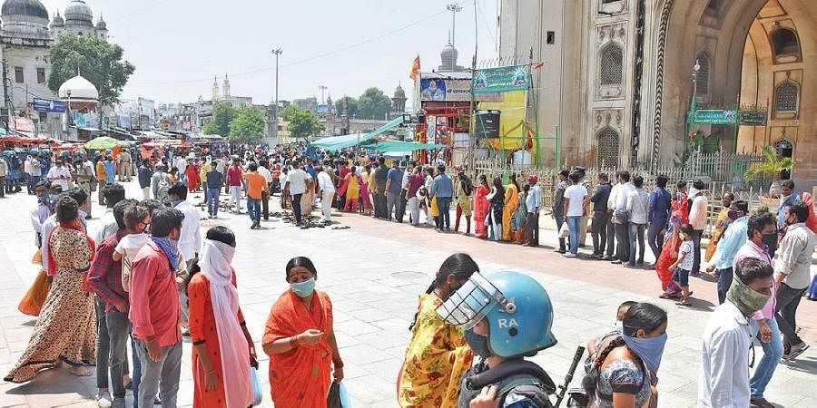 Devotees queue up in front of the Bhagyalakshmi temple near Charminar on Friday.