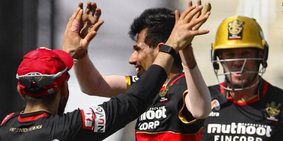 Royal Challengers Bangalore spinner Yuzvendra Chahal celebrates with teammates after picking up a wicket.