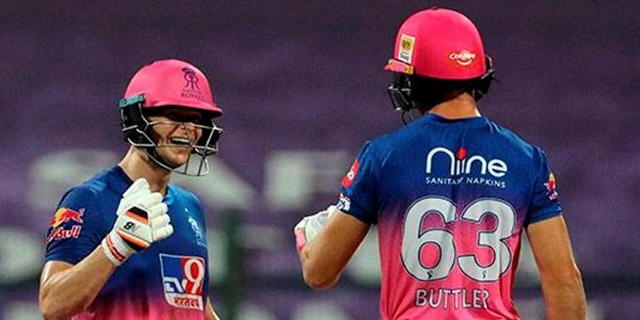 Steve Smith and Jos Buttler of Rajasthan Royals celebrate their win over Kings XI Punjab in the IPL match at the Sheikh Zayed Stadium in Abu Dhabi.
