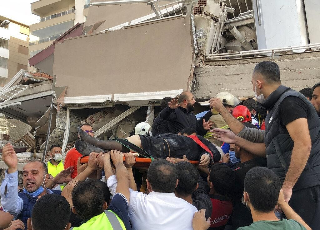 A powerful earthquake hit Turkey and Greece on Friday, killing at least 19 people, levelling buildings and creating a sea surge that flooded streets near the Turkish resort city of Izmir. (Photo | AP)