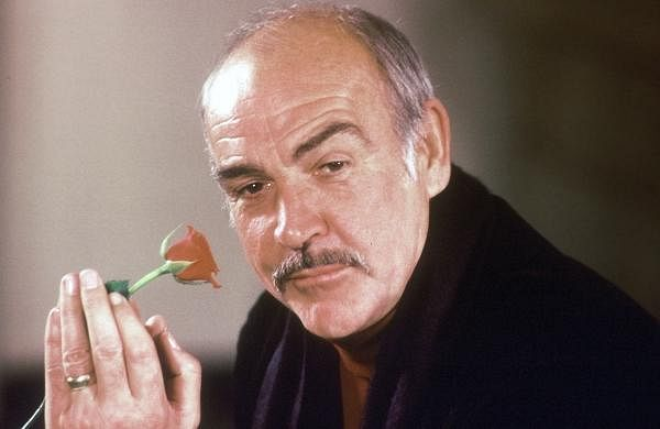In this Jan. 23, 1987 photo, actor Sean Connery holds a rose in his hand as he talks about his new movie 'The Name of the Rose' at a news conference in London.