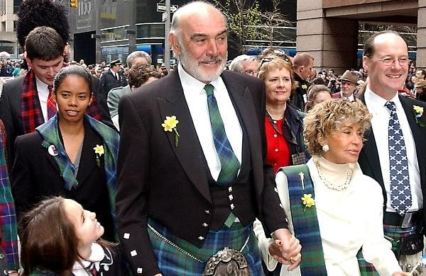 In this photo dated Saturday, April 6, 2002, Scottish actor Sean Connery, center, leads a procession up New York's Sixth Avenue as part of a bagpipe band of about 10,000, billed as the world's largest pipe and drum parade.