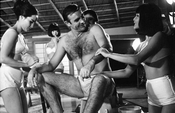 In this photo dated Sept. 26, 1966, British actor Sean Connery, being given a Japanese bath, during filming of a scene in the James Bond film, You Only Live Twice, at Pinewood Studios near London.