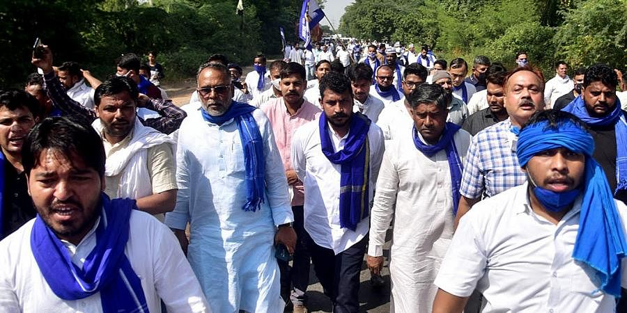 Bhim Army Chief Chandrashekhar Azad Ravan along with party workers on his way to meet the family members of the allegedly gang-raped victim, in Hathras on Sunday. (Photo | PTI)