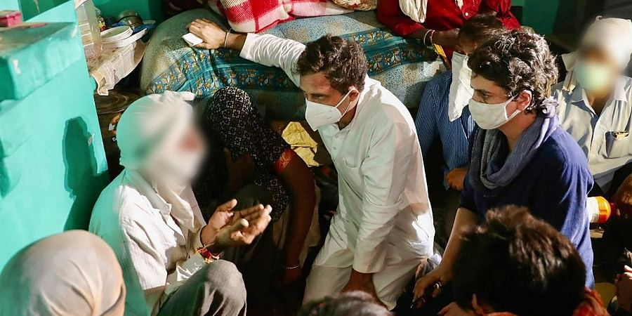 Congress leaders Priyanka Gandhi Vadra and Rahul Gandhi meet the family members of a 19-year-old Dalit woman who died after being allegedly raped two weeks ago. (Photo | PTI)