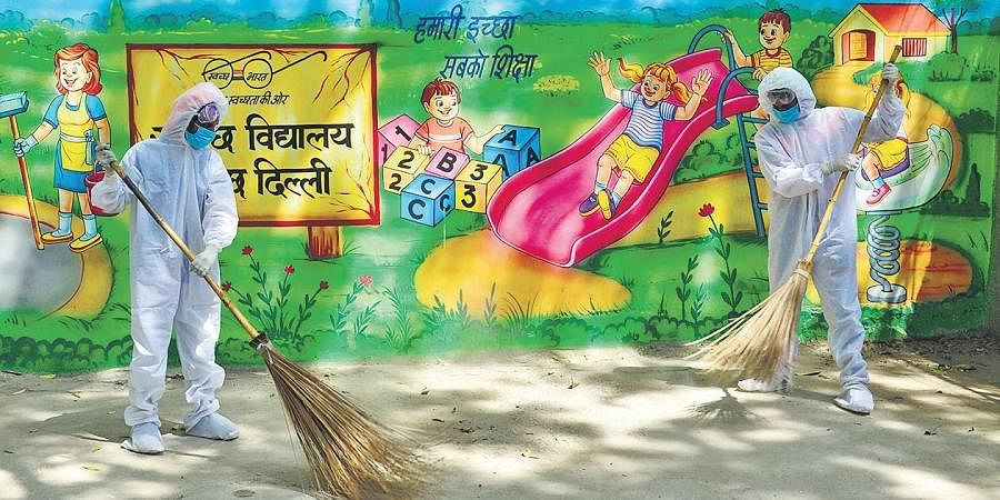 Sweepers clean a school premises even as schools remain shut during. (File Photo)