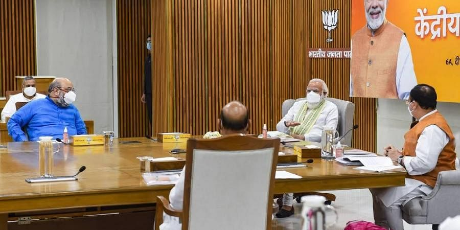 Prime Minister Narendra Modi along with Home Minister Amit Shah during Central Election Committee CEC meeting at BJP HQ in New Delhi