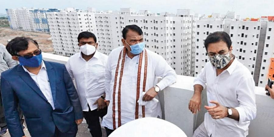MAUD Minister KT Rama Rao and Assembly Speaker Pocharam Srinivas Reddy inspect the 2BHK dignity housing project site at Kollur on Thursday to review the various amenities being provided.