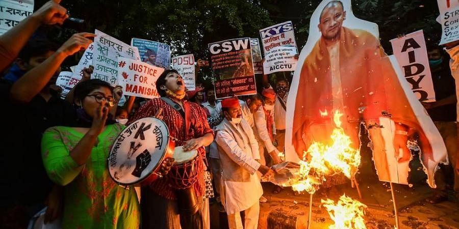 All India Students Association AISA and Samajwadi Party workers burn effigy Of UP CM Yogi Adityanath during a protest over the Hathras incident at Jantar Mantar i