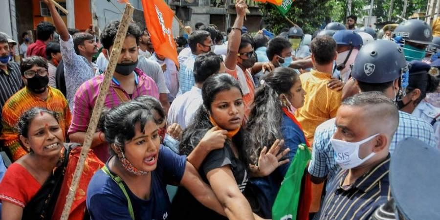 BJP workers stage a protest against the state government in Kolkata