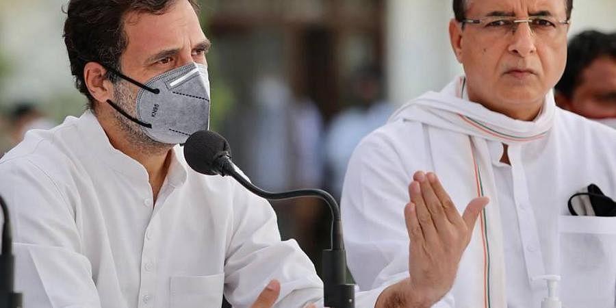 Congress leader Rahul Gandhi along with party General Secretary Randeep Singh Surjewala addresses a press conference in Patiala