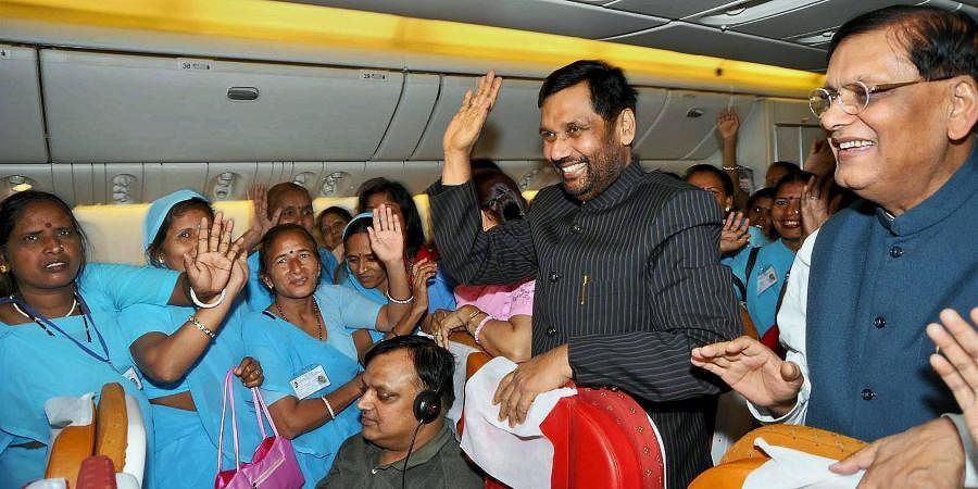 Then Union Minister of Chemicals, Fertilizers and Steel, Ram Vilas Paswan cheers a group of women scavangers on board a plane to New York. The group of women scavangers will participate in a cultural programme at United Nations.