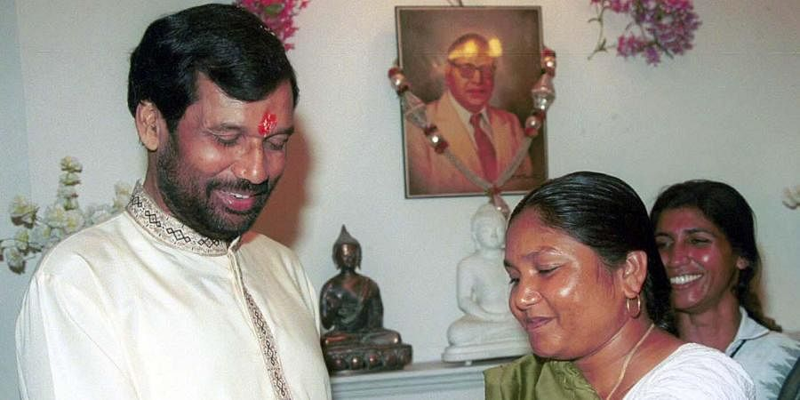 Then MP Phoolan Devi tieing the Rakhi on the wrist of Union Communication Minister Ram Vilas Paswan, on the occasion of Raksha Bandhan in New Delhi.