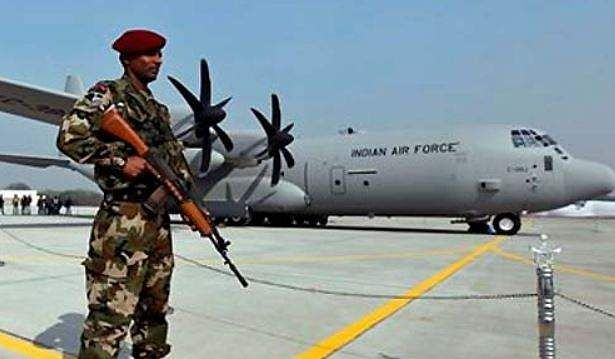 A Special Forces commando stands guard near the C-130J-30 Super Hercules aircraft at a ceremony at the Air Force Station at Hindon near New Delhi