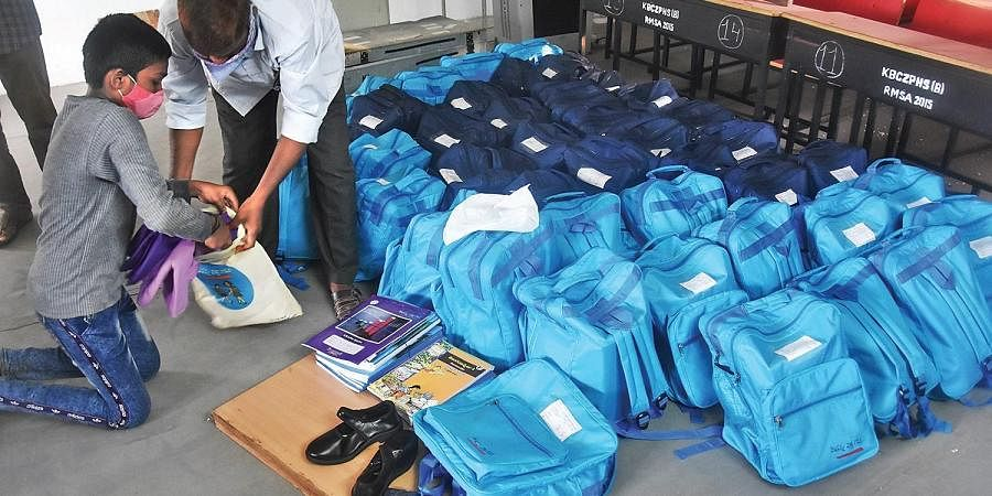 Vidya Kanuka kits being arranged for distribution at Koneru Basavaiah Chowdary ZP High School in Vijayawada.