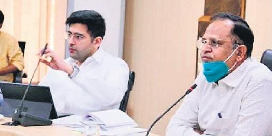 DJB chairman Satyendar Jain alongside Raghav Chadha at the meeting.