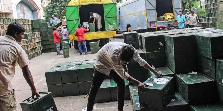 Workers arrange ballot boxes ahead of GHMC polls, at Victory Playground in Hyderabad