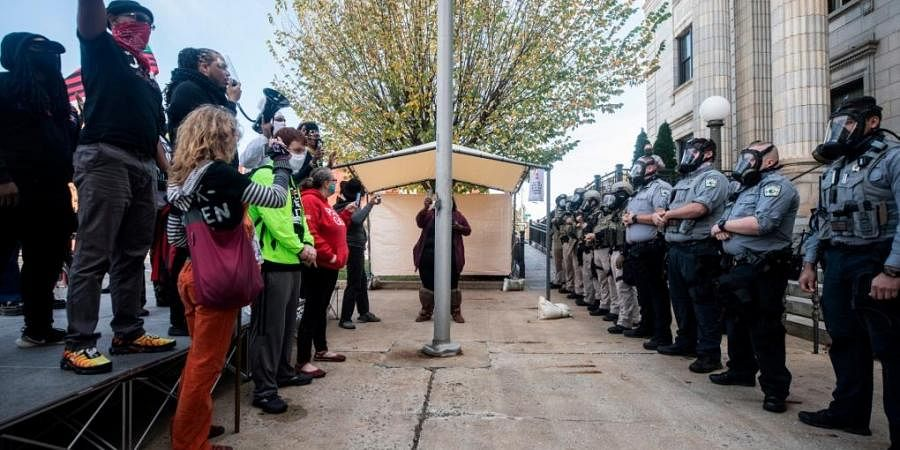 A statement from the Graham Police Department said that, officers pepper-sprayed the ground to disperse the crowd when the demonstration was deemed unsafe and unlawful'.