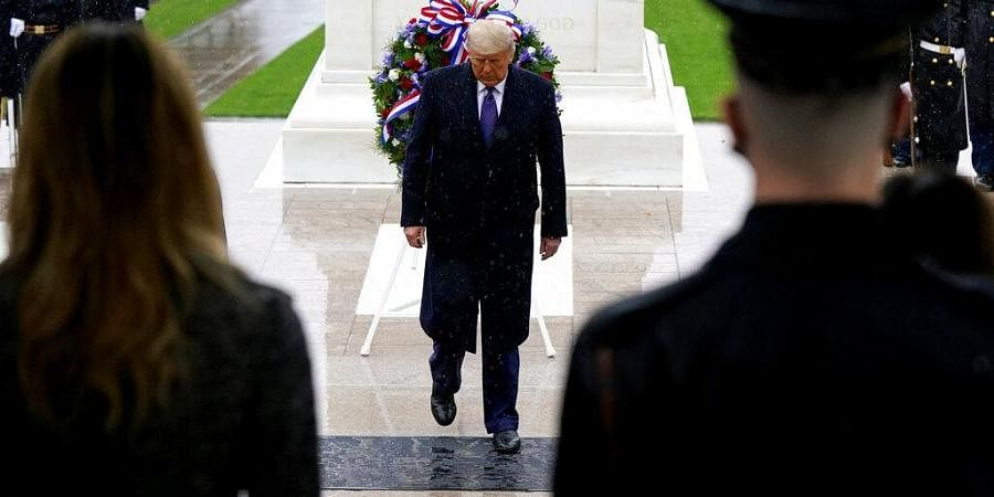 President Donald Trump participates in a Veterans Day wreath laying ceremony at the Tomb of the Unknown Soldier at Arlington National Cemetery in Arlington, Va., Wednesday, Nov. 11, 2020.