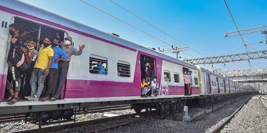Kolkata Passengers travel via local train after the authorities resumed its services from today onwards