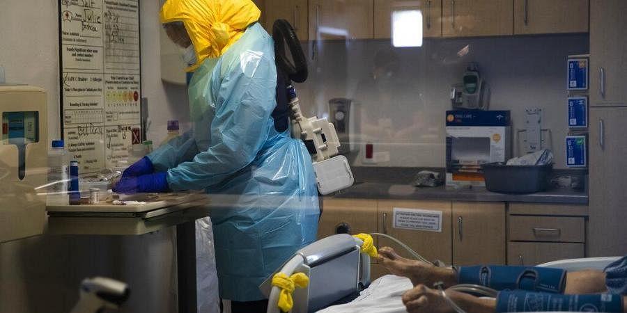 A nurse assists a COVID-19 patient at El Centro Regional Medical Center in El Centro, Calif. (Photo | AP)