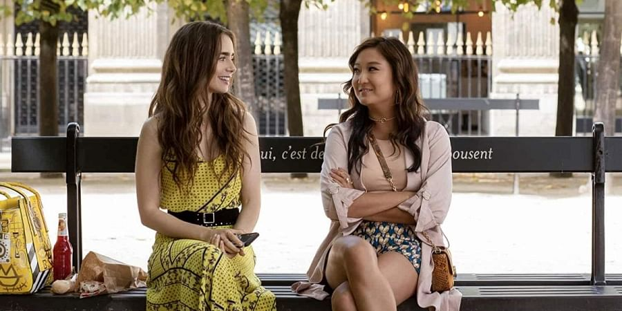 Lily Collins (L) and Ashley Park in Emily in Paris