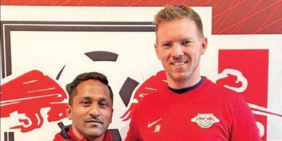 Goa assistant coach Clifford Miranda (L) with Leipzig coach Julian Nagelsmann.