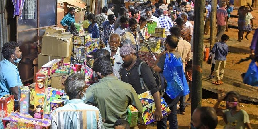 Shoppers throng shops put up at Island Grounds to buy crackers ahead of Deepavali, on Thursday. (Photo | Martin Louis, EPS)