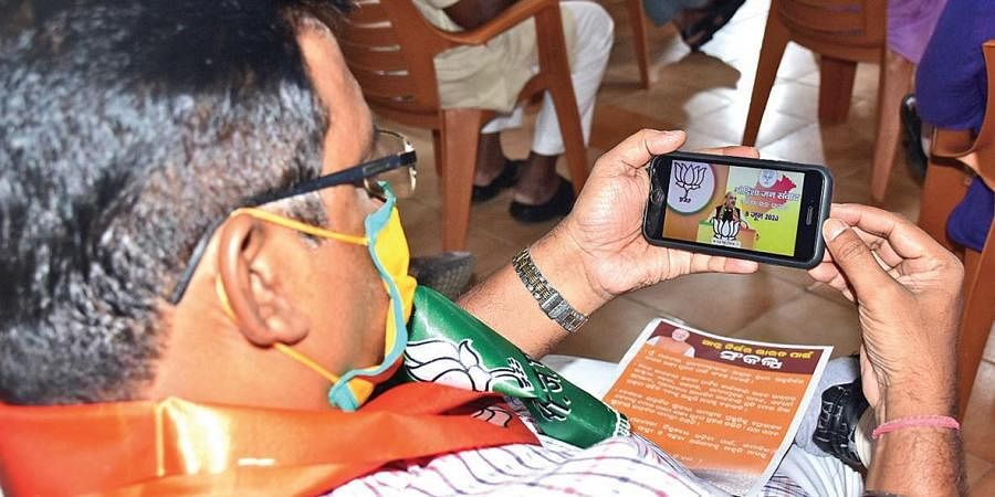 A BJP leader attending Home Minister Amit Shah's  virtual rally at a BJP party office. (Photo | EPS)