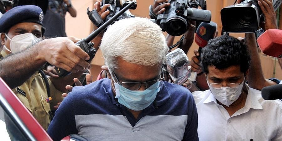 M Sivasankar enters the ED office in Kochi after being taken into custody by the central agency