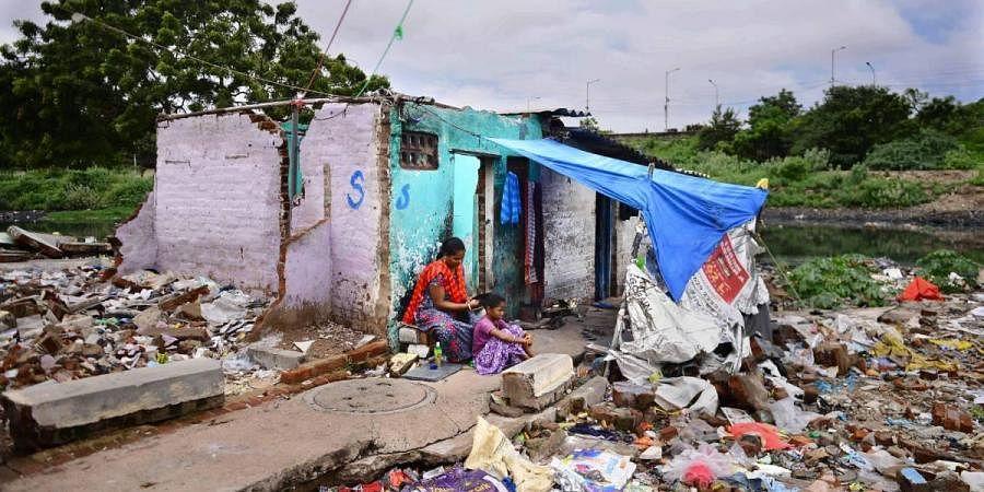 A family living amid uncleared debris at Sathyavani Muthu Nagar in Chennai. (Photo  Debadatta Mallick, EPS)