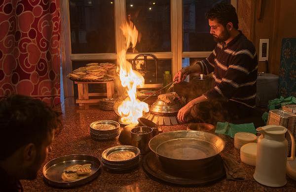 A Kashmiri man prepares 'Harisa' before serving it to customers in Srinagar.