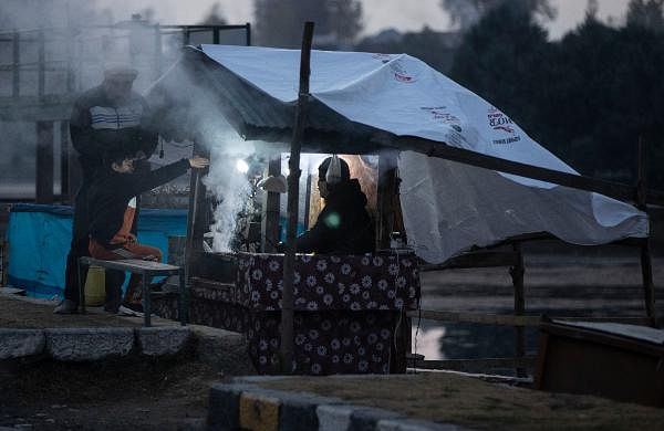 A Kashmiri vendor prepares traditional barbeque mutton for customers on the bank of the Dal Lake on a cold evening in Srinagar.