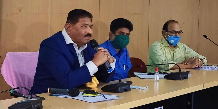 Telangana State Election Commissioner C Parthasarathi announcing GHMC election schedule at a press conference in Hyderabad on Tuesday