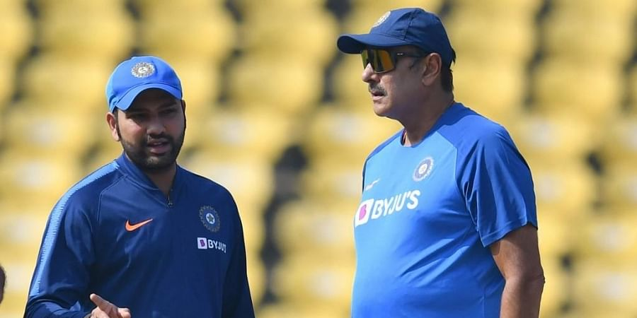 Rohit Sharma (L) speaks with coach Ravi Shastri during a training session. (Photo | AFP)