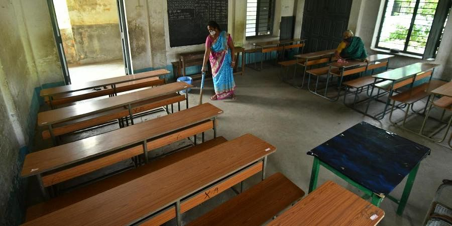 A classroom in Montessori School, Vijayawada being cleaned as the government prepares to resume classes from Monday