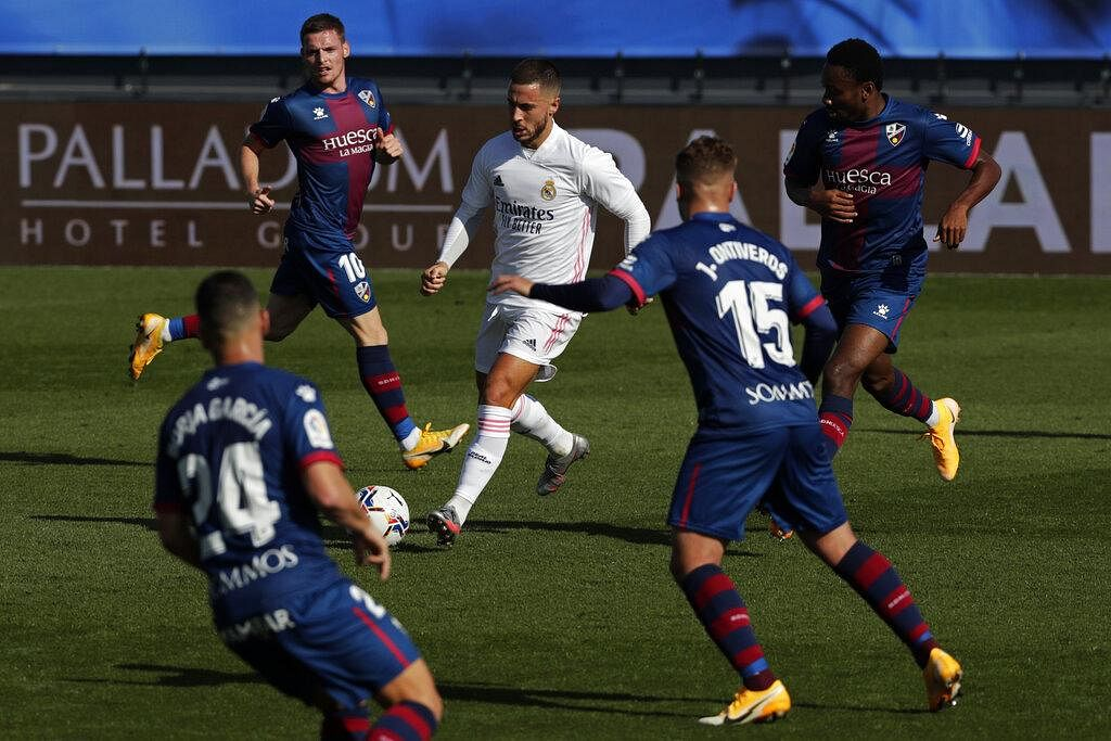 Announcing his return to starting line-up with a screamer, Real Madrid's Eden Hazard, center, scored his side's first goal after over a year-long gap against Huesca during the Spanish La Liga match. (Photo | AP)