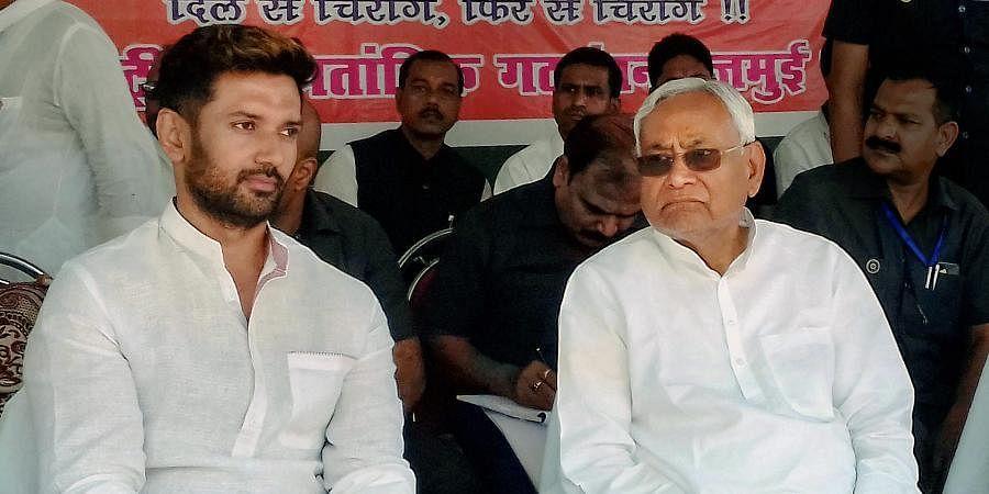 LJP president Chirag Paswan (L) with Bihar CM Nitish Kumar
