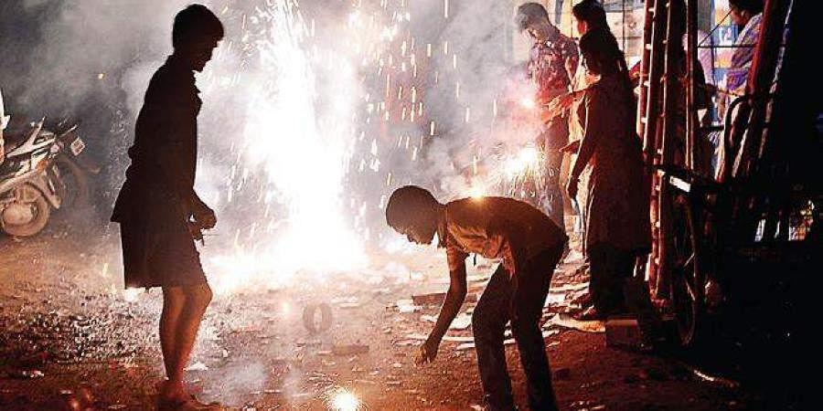 Residents of Anna Nagar West bursting crackers on Sunday.