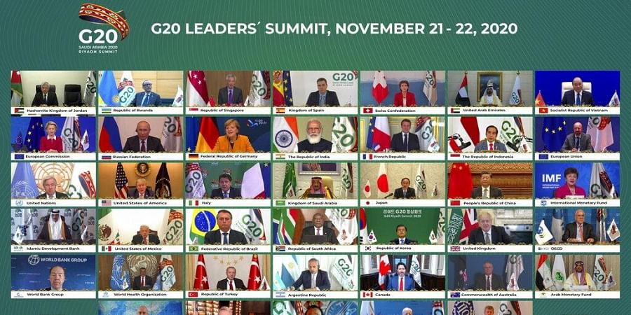 This handout photo provided by G20 Riyadh Summit, shows Saudi King Salman, center, and the rest of world leaders during a virtual G20 summit hosted by Saudi Arabia and held over video conference.