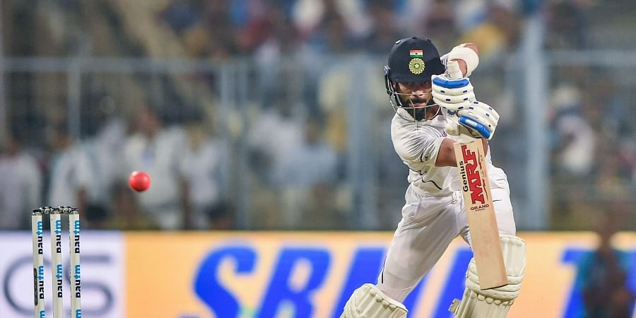 Indian Skipper Virat Kohli plays a shot during the 1st pink-ball day/night cricket test match between India and Bangladesh at Eden Gardens. (Photo | PTI)