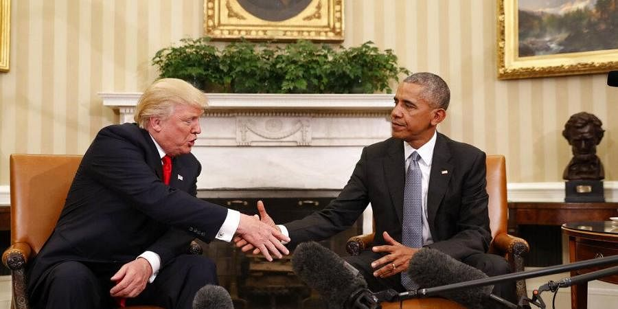 Former President Barack Obama shakes hands with then President-elect Donald Trump in the Oval Office